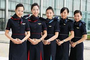 Бортпроводники авиакомпании Hong Kong Airlines берут уроки кунг-фу